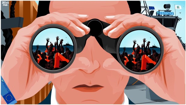 A suited man on a Frontex boat looks through binoculars at people in a dinghy