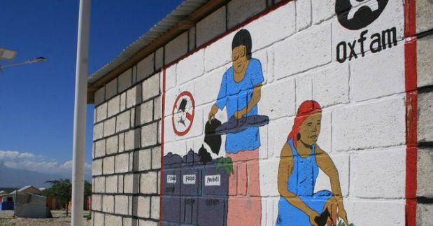 Public health hygiene painting on latrines, in a temporary camp, Haiti