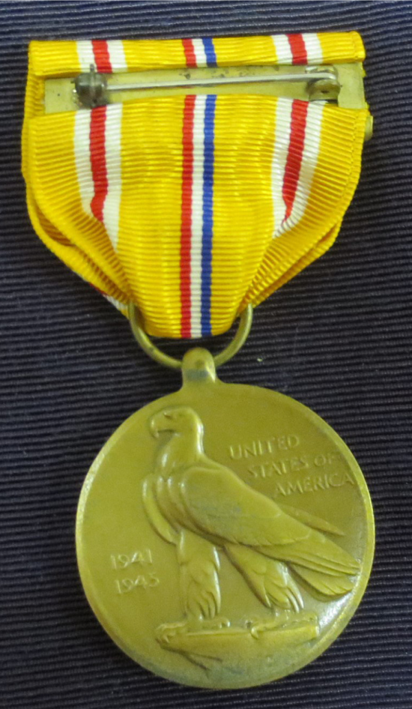 Back portion of the medal with yellow ribbon