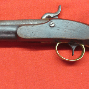 Boclock pistol lying on red surface
