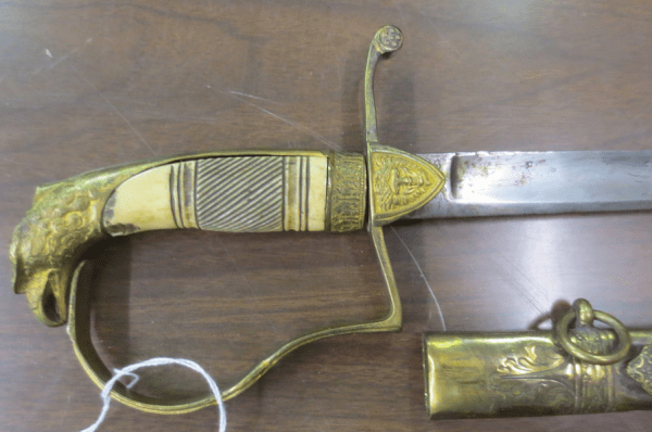 Gold sword handle with designed engraving