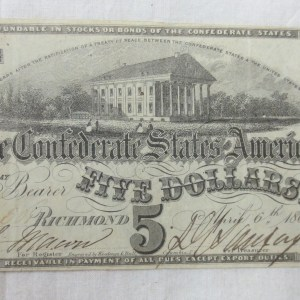 Front page of five dollars currency