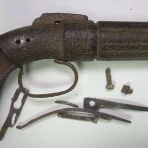 Dismantled curved pistol