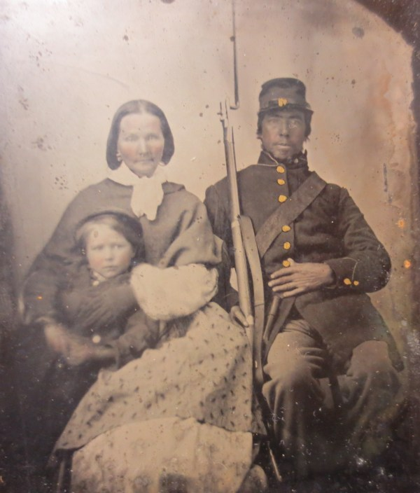 Picture of a war veteran with wife and child