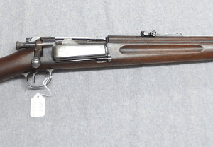 Brown shotgun with tag