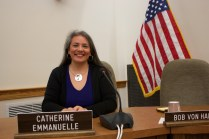 Eau Claire City Council person Catherine Emmanuelle sits at her desk in the city council chambers