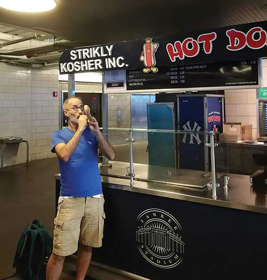 Rabbi Greg Alexander blowing the shofar at Yankee Stadium during Elul while on sabbatical in New York City with his family