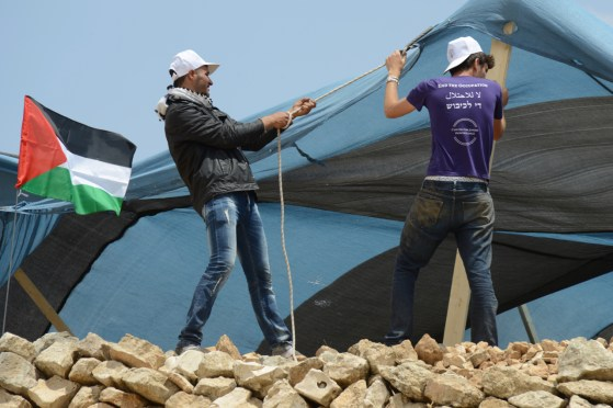 Setting up the Tent at Sumud: Freedom Camp