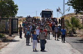 Returning with residents of Susiya to their former homes