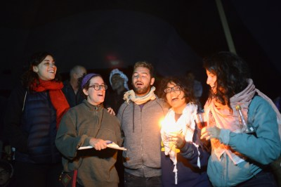 Saturday night Havdallah prayers and singing, hours before the army violently raids the camp