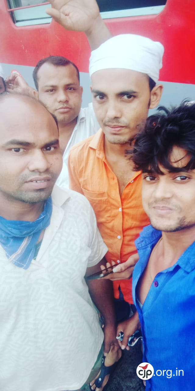 Munna Sheikh (waving) after reaching Katihar with his friends