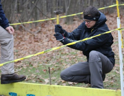 Ben Rollenhagen, one of the event coordinators, setting up the course for La Frost Cross on Saturday, Dec. 3, 2016 in Mount Pleasant, MI.