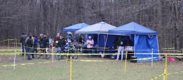 Racers and volunteers congregate together at the tents that have free food and drinks and race information at the La Frost Cross on Saturday, Dec. 3, 2016 in Mount Pleasant