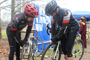 Athletes check their bike's tire pressure before the race at La Frost Cross on Saturday Dec. 3, 2016 in Mount Pleasant, MI.