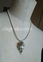 「琥珀・ペリドット・水晶のヘアクリップ」をフルリフォームしたネックレスです☆
