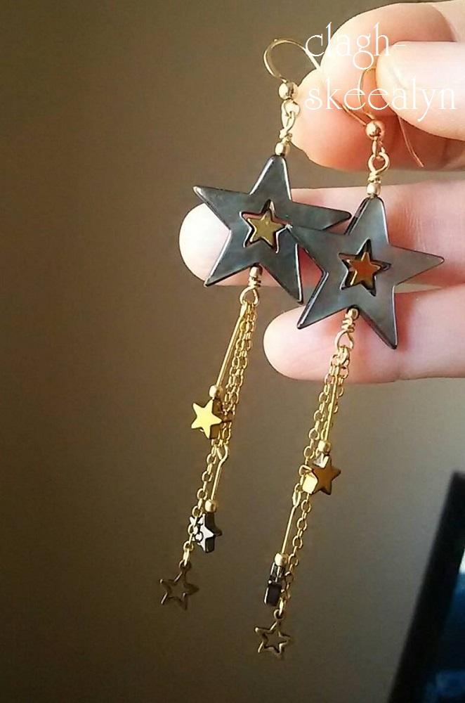 25mmの星型マザーオブパール(黒)&ヘマタイト(ゴールドコーティング)を使用した、silver925のピアスです♪