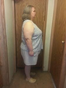 profile image of Sarah in front of door
