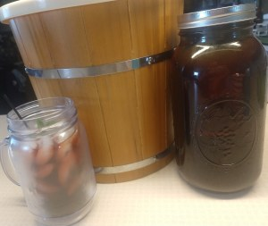 cold brew coffee steeping with a cup ready to enjoy