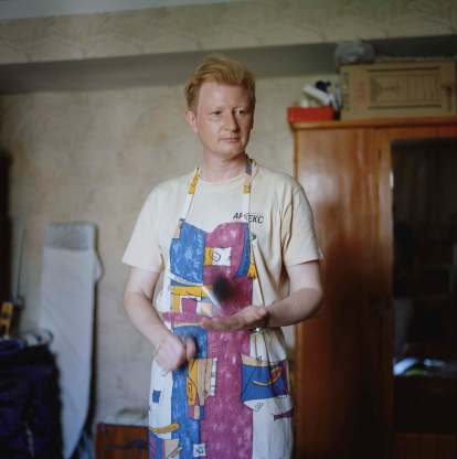 Crimea. Sevastopol. Dima is helping to prepare dinner at home. From the series 'Crimean Diaries' 2014