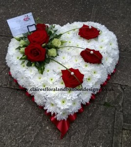 Funeral heart tribute with red roses