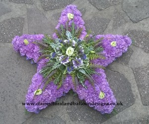 Lilac star shaped funeral tribute