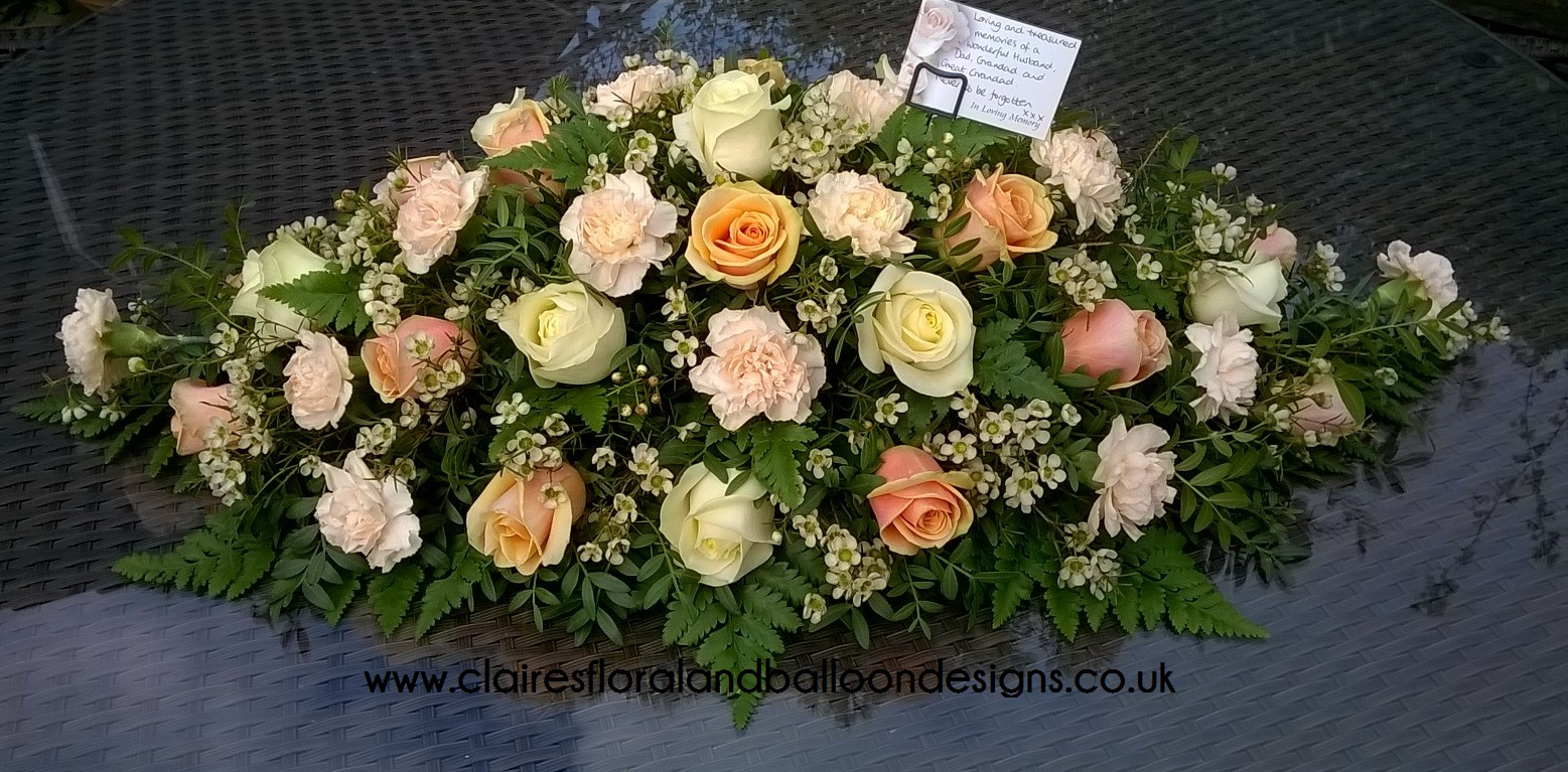 Fabulous floral designs norwich florist balloon designs for peach and cream funeral coffin spray izmirmasajfo