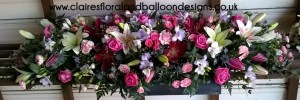 Multi coloured floral funeral coffin spray
