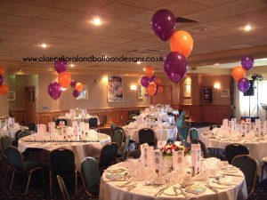 3 balloon table centres in purple and orange