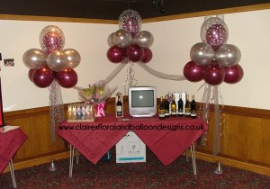 Cloud nine balloon arrangements to frame a prize table