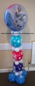 Frozen themed balloon column with giant balloon topper