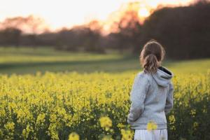 Girl in rape seed field, Horsham, sussex