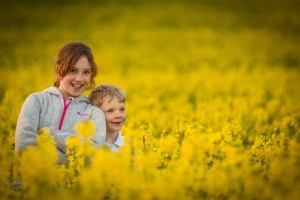 Children amongst the rape seed, sussex