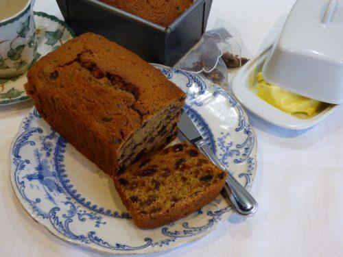 fruit tea loaf on a blue plate