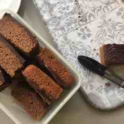 Slices of cake on a grey tray.