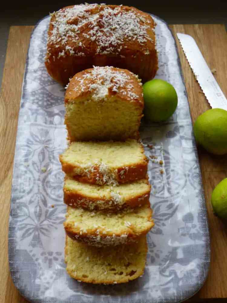 Coconut and Lime loaves. Sliced on a grey pattered plate.