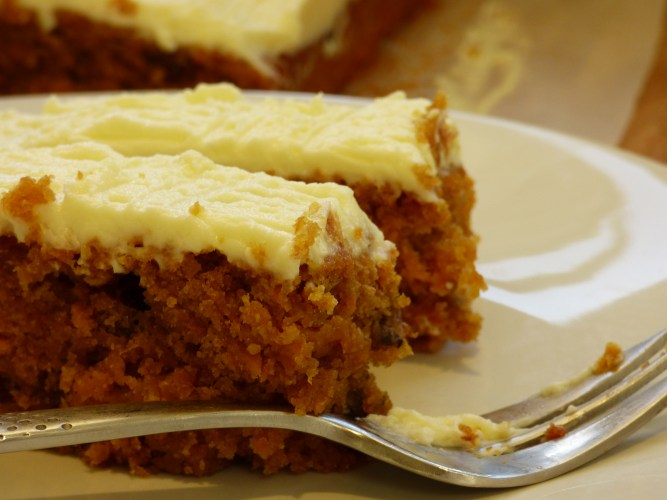 Olive Oil, Carrot and Raisin Cake with a cream cheese frosted topping.
