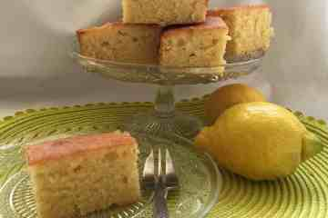Lemon Drizzle cakes on a glass cake dish