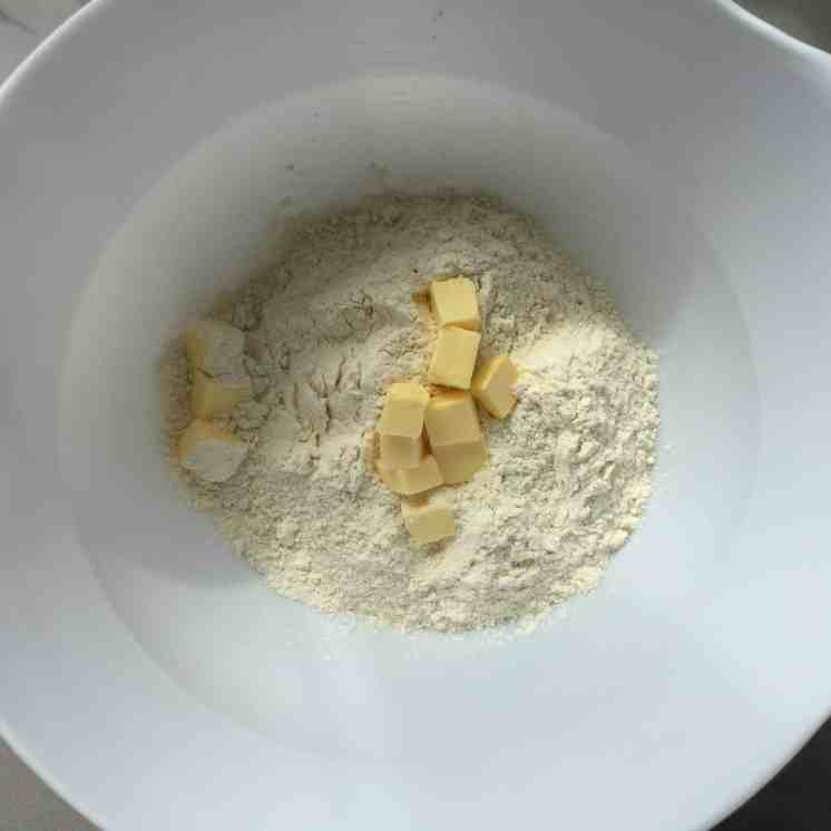 Butter and flour in a white bowl.