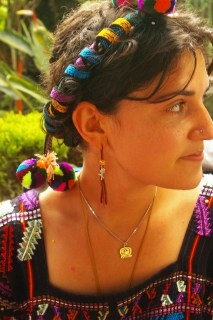 Nebaj, Guatemala. Danielle, in the 'traje' of Chajul, complete with cinta, arretes, and huipil.