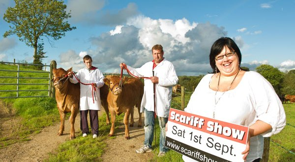 Joanne Allen, Scariff Show secretary, with cattle section committee member, Owen Flannery, centre, and competitor, Paddy Burke at the launch of Scariff Show, which takes place on Saturday, September 1. The cattle classes are being reintroduced after a gap of almost two decades. Photograph by John Kelly