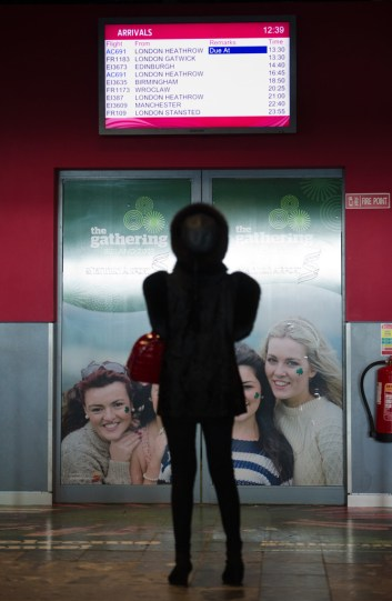 A woman keeps an eager eye on the arrivals screen at Shannon Airport for a loved one's arrival home fro Christmas. Photograph by John Kelly.