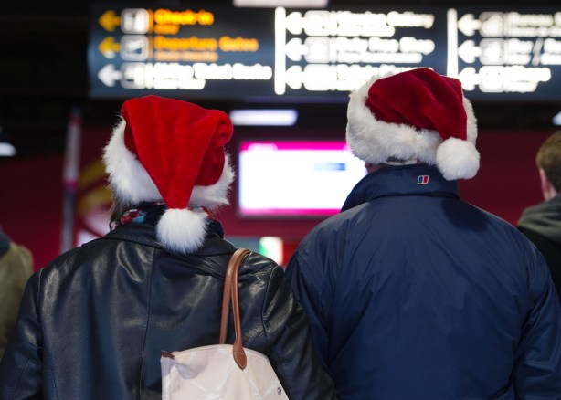 A couple keep an eager eye on the arrivals screen at Shannon Airport for a loved one's arrival home for Christmas. Photograph by John Kelly.
