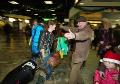 Gerry Broderick of Ennis greeting his daughter Sarah on her arrival home for Christmas from Maine, USA at Shannon Airport as her mother Liz is pictured at right. Photograph by John Kelly.