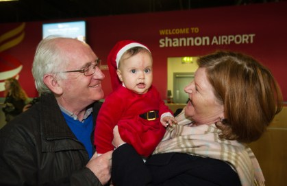 Little Kyra Kenihan is greeted by her grandparents Eddie and Bridgid Kenihan of Corbally, after meeting her for the first time in person at Shannon Airport on her arrival home for Christmas from Sydney. Photograph by John Kelly.