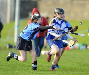 Corinna Mc Mahon of St Flannan's in action against Aoife Galvin of St Mary's Charleville during their Munster Senior A Colleges Camogie championship final at Newmarket. Photograph by John Kelly.
