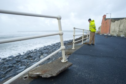 The railings at Lahinch promenade were damaged in last night's storm. Photograph by John Kelly.