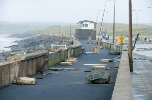 Debris is strewn across Lahinch promenade. Photograph by John Kelly.