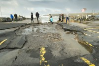 The road adjacent to Doolin pier with a series of craters following the storm. Photograph by John Kelly.