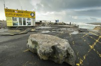 A huge rock delivered by high seas on road adjacent to Doolin pier following the storm. Photograph by John Kelly.