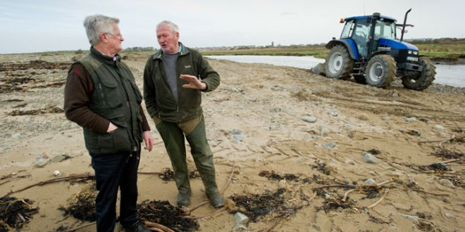 Tommy Comerford of the local Coastal Erosion Group with local farmer Paddy Doyle, whose land at Rhynagonnaught is damaged following the recent storms.